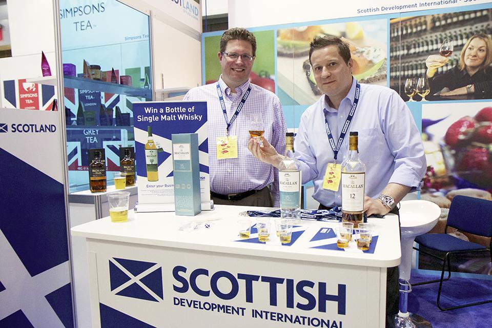 Representatives from Scottish Development International with Macallan whiskey.