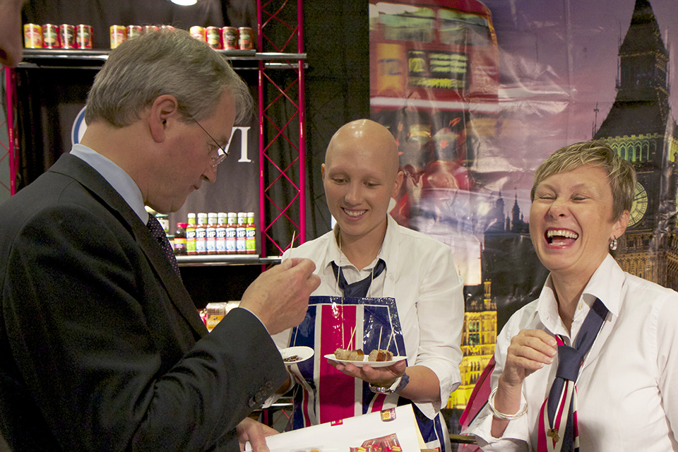 Owen Paterson tries the food samples from British companies.