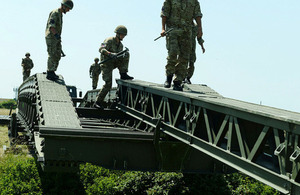 British airborne engineers deploying a 100-foot Medium Girder Bridge [Picture: Corporal Obi Igbo, Crown copyright]