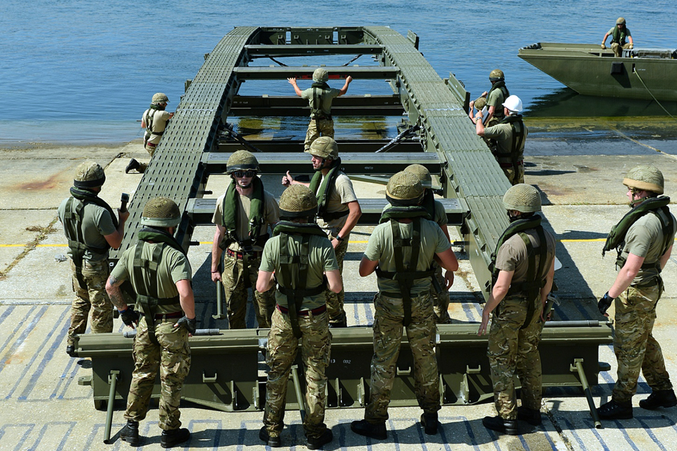 British Army sappers prepare to set up an Air Portable Ferry Bridge