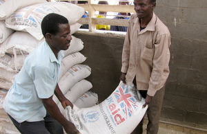 Distributing UK-funded food aid with the World Food Programme in Malawi. Picture: WFP/Greg Barrow