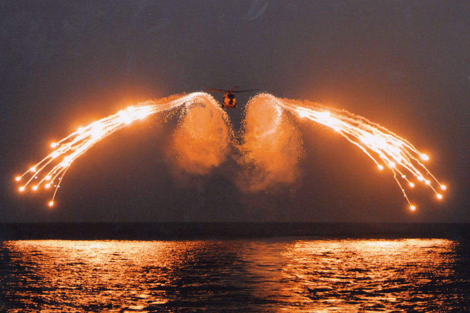 A Merlin helicopter test-firing decoy flares