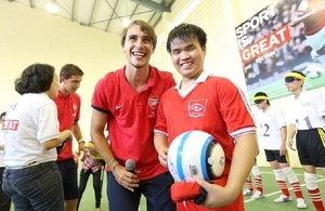 Arsenal players play football with visually impaired children in Hanoi