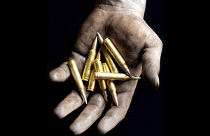 5.56mm rounds being held in the hand prior to loading into a magazine (library image) [Picture: Petty Officer (Photographer) Sean Clee, Crown copyright]