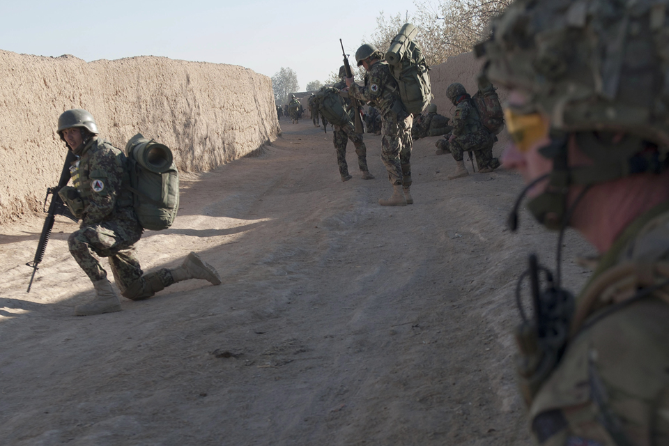 A 1 SCOTS soldier takes a knee