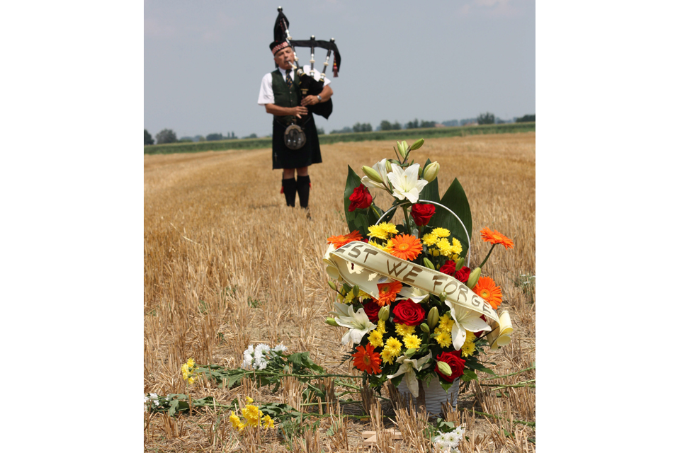 A lone piper plays a lament at the crash site of Boston BZ590