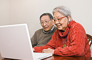 Elderly couple on the computer