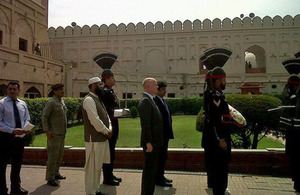 Foreign Secretary William Hague about to lay a wreath at the tomb of the poet Iqbal in Lahore.