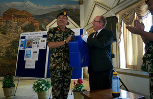 Ambassador Sparkes presents Brigadier General Basnyat with one of the Lifesaver jerry cans