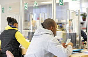 Customers at a DVLA local office