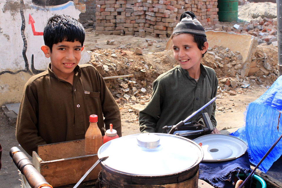 Two young boys selling food on the streets.