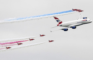 Red Arrows Hawk jets in formation with a British Airways Airbus A380 at the Royal International Air Tattoo [Picture: Senior Aircraftman Lee Matthews, Crown copyright]