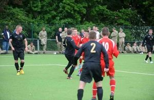Scottish soldiers play on the new pitch [Picture: Crown copyright]