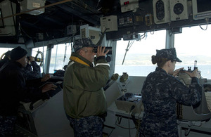 Captain Robert Hein of the United States Navy looks out from the bridge of the guided-missile cruiser USS Gettysburg