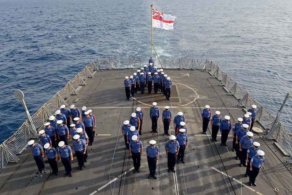 Members of HMS Kent's ship's company celebrate the royal birth