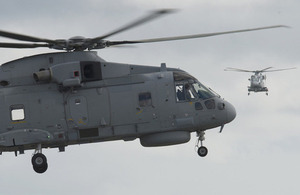 Two new Merlin Mk2 helicopters in flight at Royal Naval Air Station Culdrose [Picture: Andrew Linnett, Crown copyright]