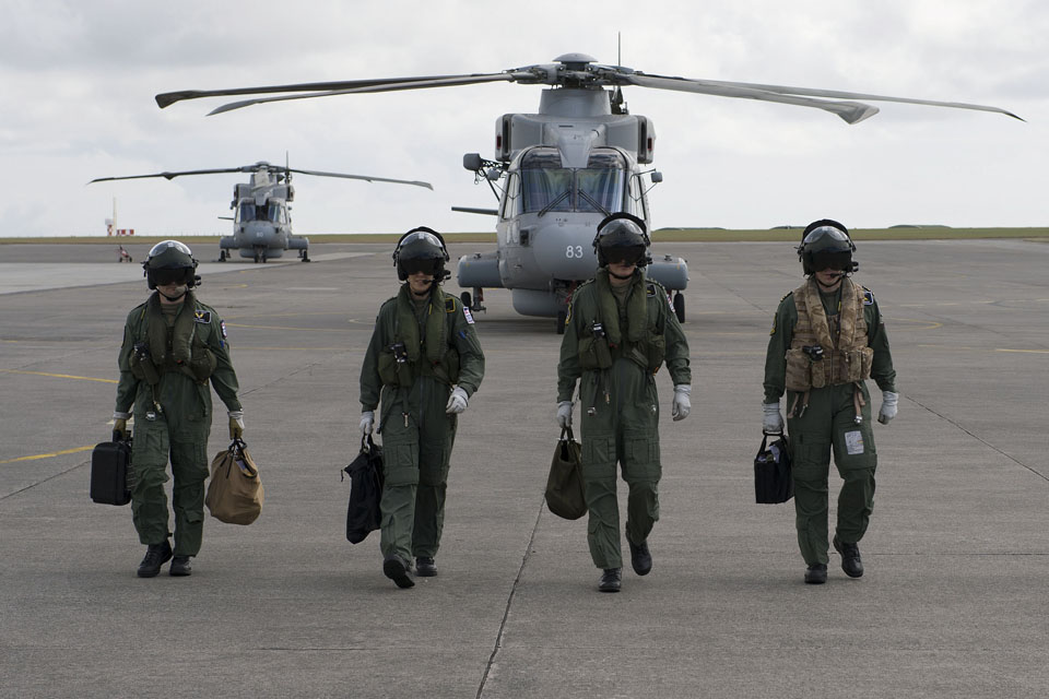 Crew members leaving two of the new Merlin Mk2 helicopters