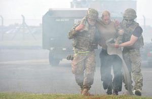 Members of Number II (Army Cooperation) Squadron evacuate a 'casualty'