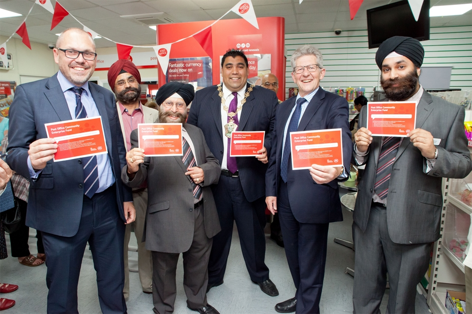 Communities Minister Don Foster with staff of the Wood St Post Office, Walthamstow
