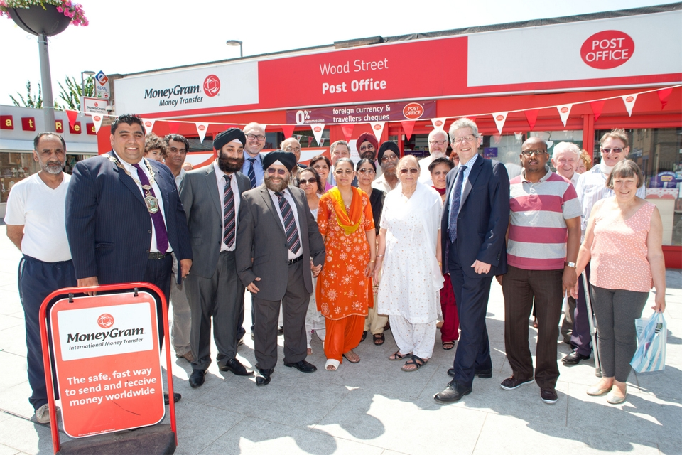 Communities Minister Don Foster with staff and customers at the Wood St Post Office, Walthamstow