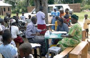 Kakamega highlands, Kenya: health officials test for malaria.