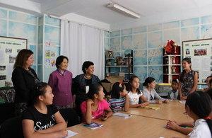 HM Ambassador conversing with students