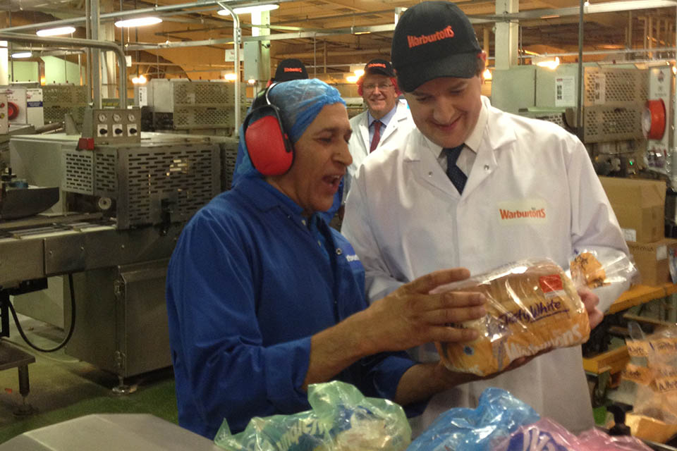 Chancellor and a shift worker at Warburtons inspecting a loaf of bread