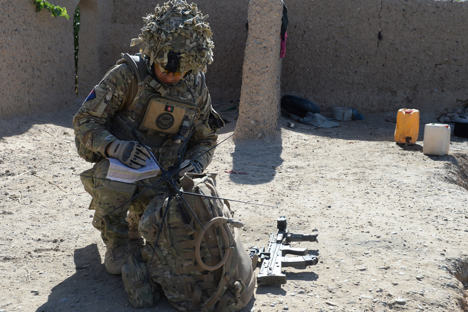 A soldier using the PRC-177F tactical satellite radio