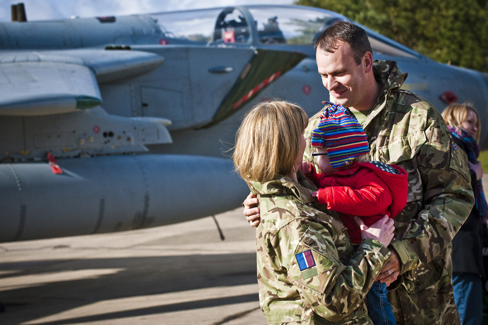 A Royal Air Force married couple with their baby daughter (stock image)