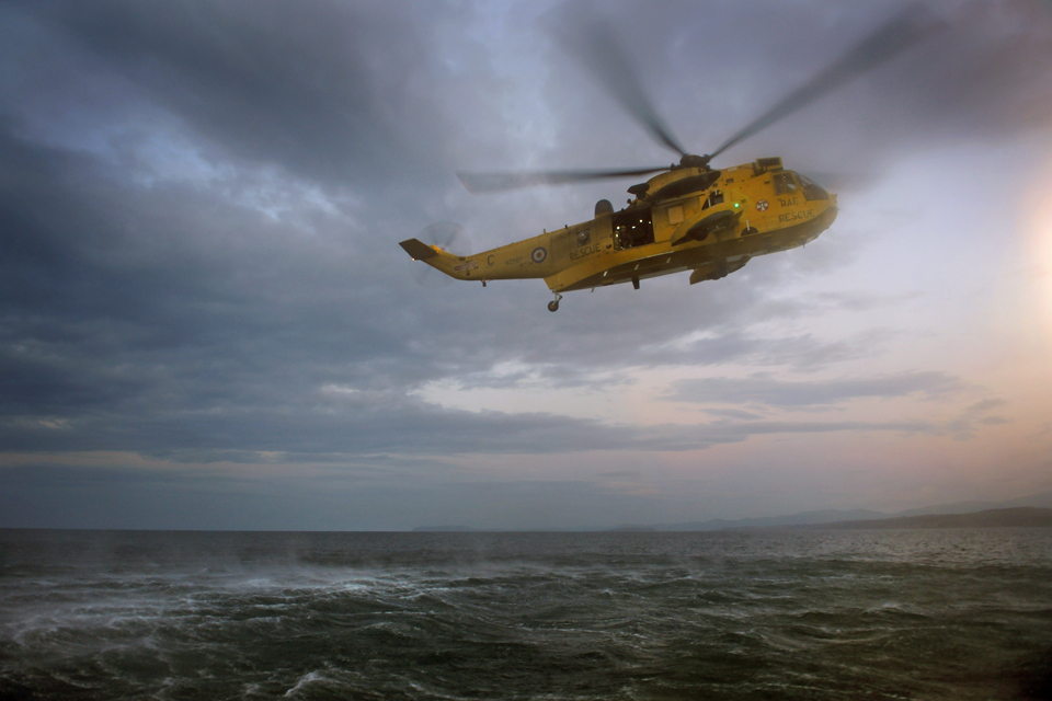RAF Sea King search and rescue helicopter over the sea (stock image)