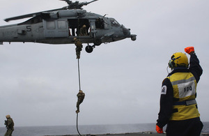 United States Marines fast-rope onto HMS Dragon's deck during an exercise [Picture: Crown copyright]