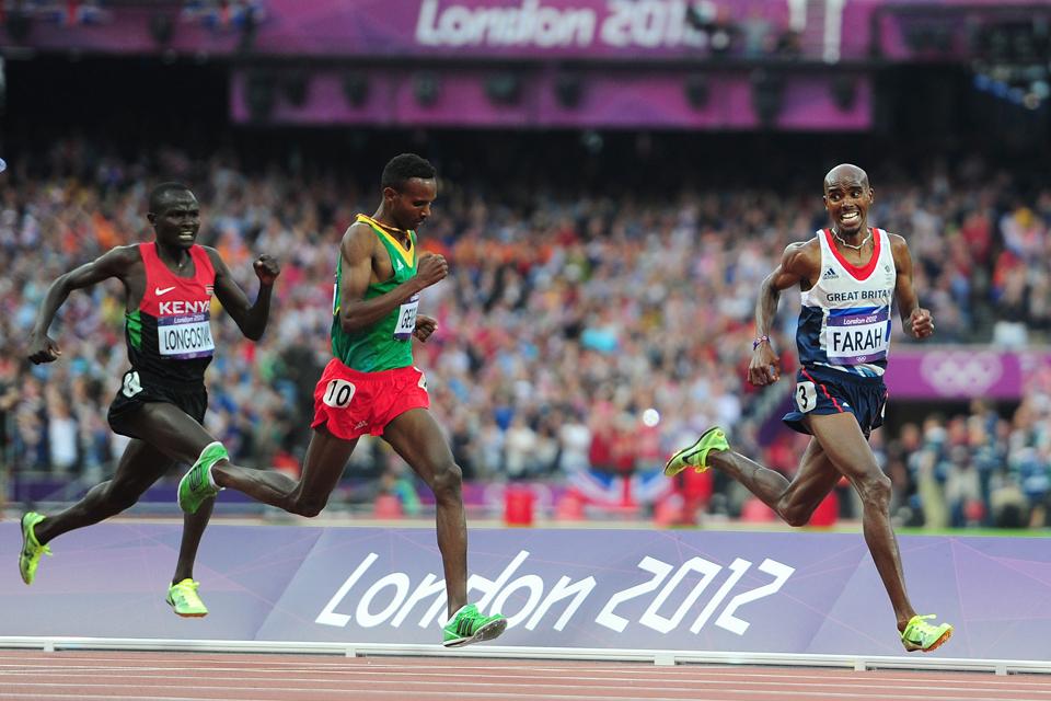 Mo Farah laimi vyrų 5000 metrų bėgimo finalą. Nuotrauka: Adam Davy/PAWire.
