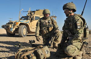 A Rifles reservist serves alongside a regular Army colleague on operations in Helmand province