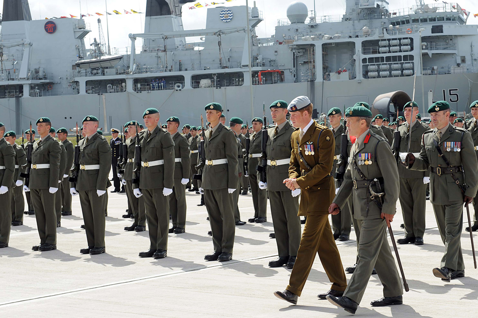 Prince Harry reviews the parade of 1 Assault Group Royal Marines personnel