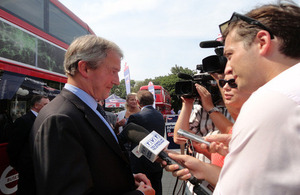Minister Owen Paterson interviewed in front of the GREAT New Bus for London