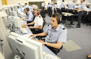 Royal Air Force and Royal Navy air traffic controllers in the new Atlas control room at the Air Traffic Control Centre in Swanwick