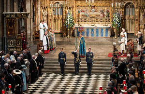 Flight Lieutenant Alister Barker (centre) carries the standard of 32 (The Royal) Squadron at Westminster Abbey, escorted by Flight Lieutenants Jonathan Humphreys and Ian Davies