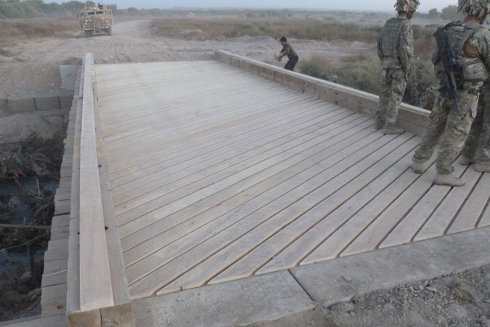 Angled planks of locally sourced timber top the finished bridge