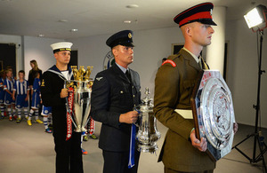 From left: Royal Navy, RAF and Army Reservists bring the Premier League, FA Cup and Community Shield trophies onto the pitch before the match [Picture: Michael Regan/The FA]