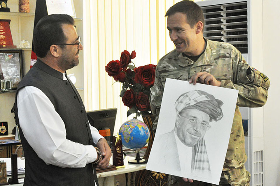 Brigadier Doug Chalmers presents the outgoing Governor of Helmand province, Gulab Mangal, with a portrait