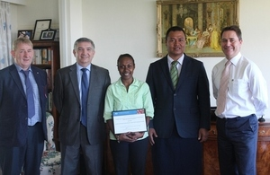 Janice Mose displaying her Chevening certificate with Foreign Affairs Minister Clay Forau, British High Commissioner Dominic Meiklejohn (on her left) and Colin Barratt, Simon Gore (on her right).