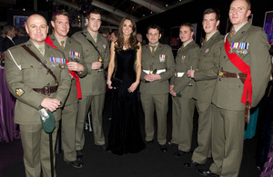 The Duchess of Cambridge with members of 42 Commando Royal Marines who received the award for Best Unit last year