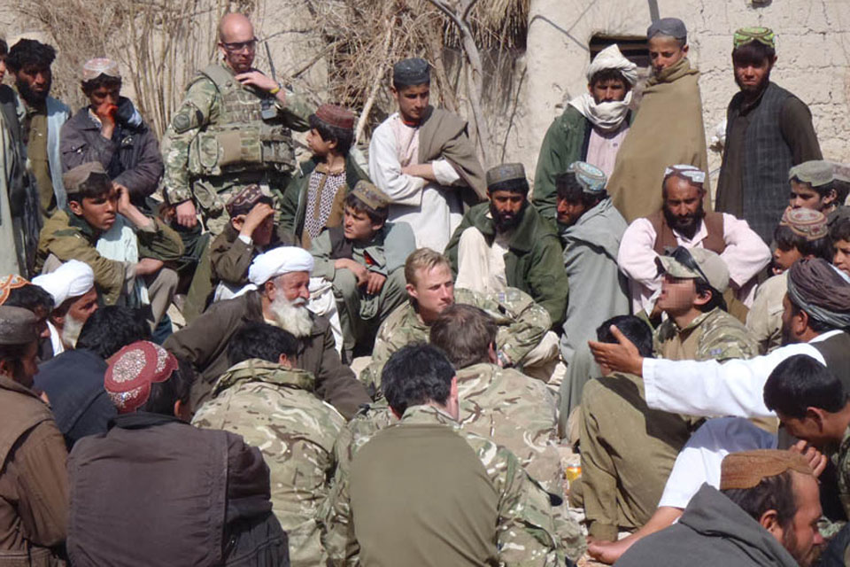 British soldiers hold a shura with Afghan villagers in Helmand province (library image)