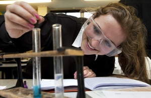 Female science student looking at test tubes in a laboratory