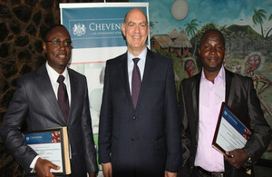 High Commissioner (centre), flanked by 2013/14 awardees