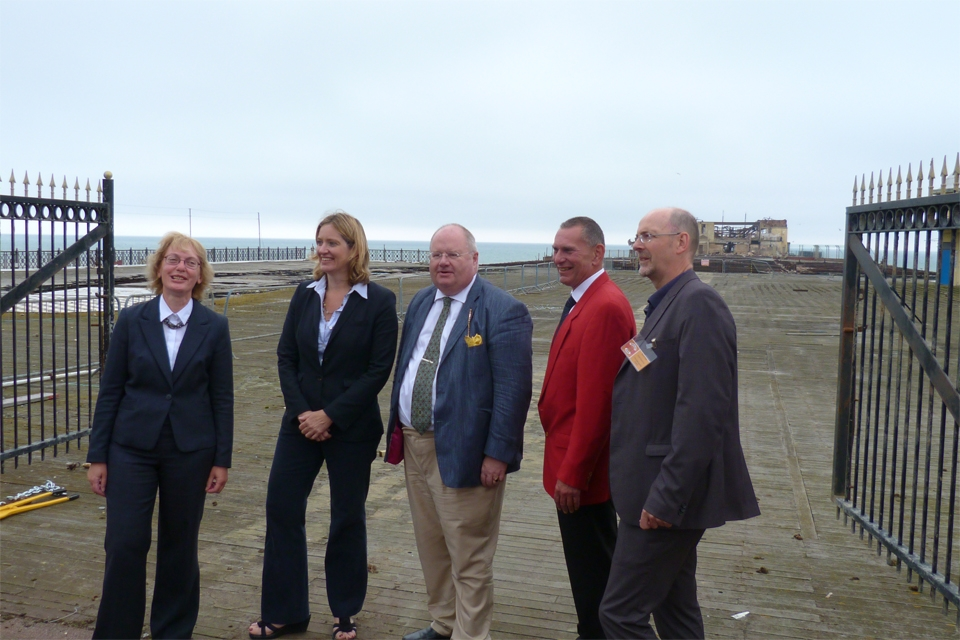 Local MP Amber Rudd, Eric Pickles, Simon Opie Chief Executive of Hastings Pier Charity, and others at opening of work on Hastings Pier.