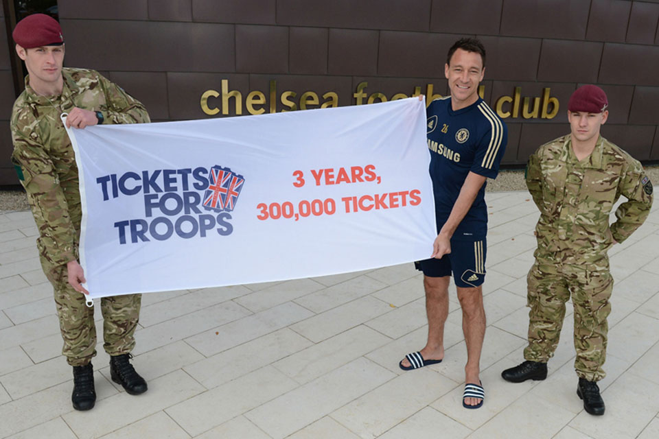 John Terry joins British soldiers to celebrate the issue of the 300,000th ticket by Tickets for Troops