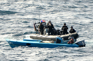 A high-speed pursuit boat intercepts the 30-foot drug-carrying vessel