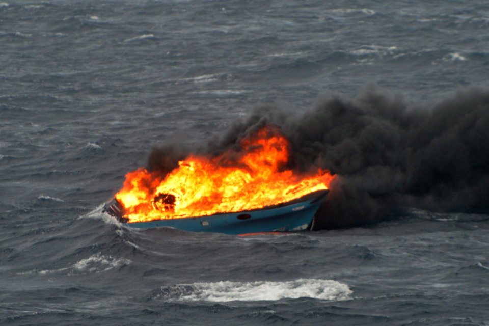 The drugs boat burns after being hit by Royal Navy gunfire [Picture: Leading Airman (Photographer) Jay Allen, Crown copyright]
