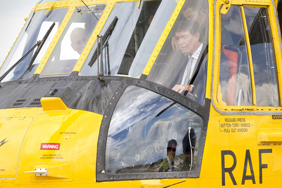 Mr Dunne is shown around the cockpit of an RAF Sea King search and rescue helicopter